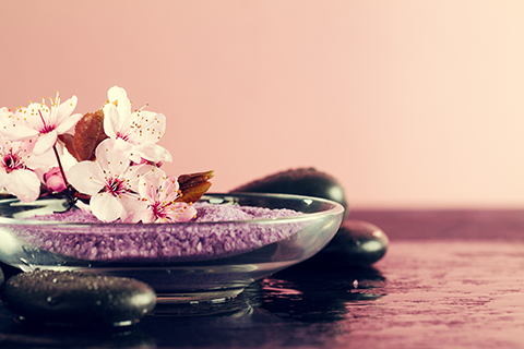 Spa Concept. Closeup of beautiful Spa Products - Spa Salt and Fl